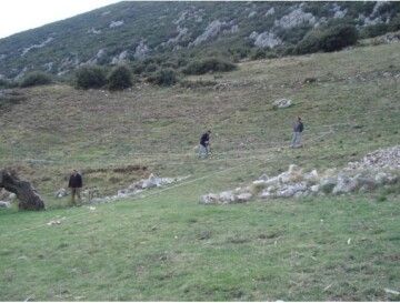 Members of the survey team take measurements during the electrical mapping of the theatre of Ancient Askra (November 2012)